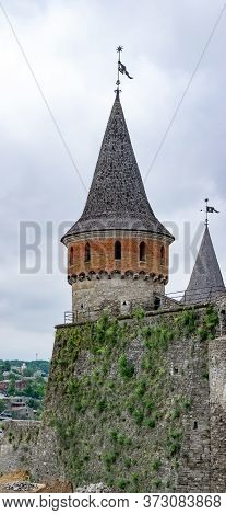 Ancient Fortress Tower Close-up View. The Rozhanka Tower And Moss Covered Defensive Wall. Medieval K