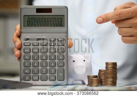 Close Up Of Male Hand Holding Portable Electronic Device For Calculations While Gentleman Standing B