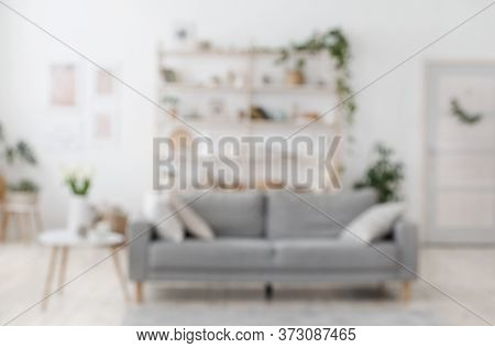 Blurred Image Of Modern Living Room Interior With Gray Sofa, Defocused Shot, Copy Space