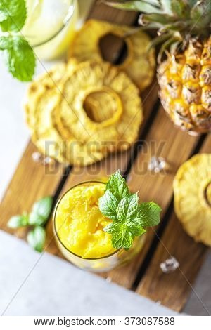 Homemade Pineapple Sorbet Ice Cream In A Glass On A Wooden Background.