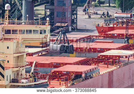 Bulk Carrier - Merchant Vessel At The Transhipment Terminal In A Seaport