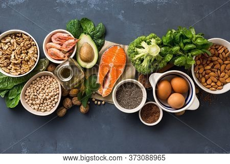 Health Food Fitness. Food Sources Of Omega 3 On Dark Background Top View. Foods High In Fatty Acids