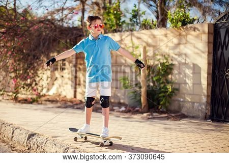 Kid Boy With Skateboard. Childhood, Leasure And Lifestyle Concept