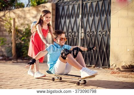 Kids With Skateboard Outdoor. Childhood, Leasure And Lifestyle Concept