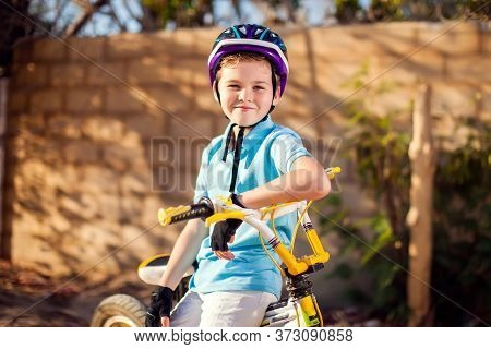 Boy With A Bicycle. Childhood, Leasure And Activity Concept
