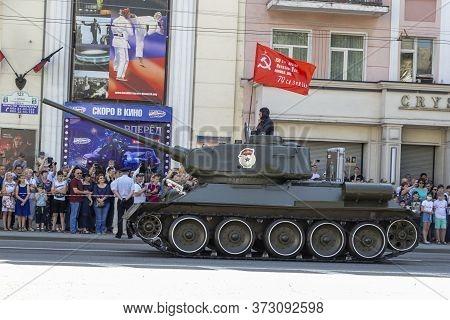 Donetsk, Donetsk People Republic, Ukraine - June 24, 2020: Soviet Tank T-34 Rides Along The Artema S