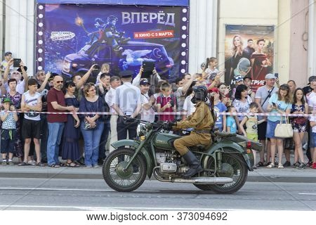 Donetsk, Donetsk People Republic - June 24, 2020: Military Men On Motorcycles Of The Second World Wa