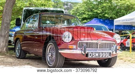 Skradin Croatia June 2020 Classic Old Timer Mgb Gt In Red Color, Aston Martin Db5 Lookalike. Looking