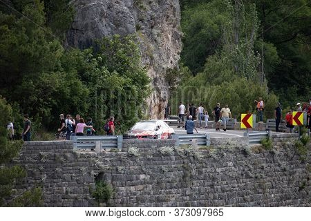 Skradin Croatia, June 2020 Red And Black Mitsubishi Lancer Descending From The Hill During A Race, S