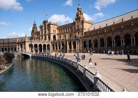 Seville, Spain - October 20, 2019: Tourists Sightseeing Around Plaza De Espana In Seville, Spain At Sunny Day. Amazing Architecture.