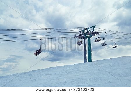 Ski Lift And Blue Sky. Sheregesh Ski Resort. People Are Lifting On Ski-lift In Mountains.