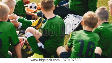 Soccer Football Coach Having Tactic Strategy Speech With Kids Team. Kids Listening Coachs Strategy S
