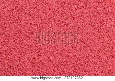 Pink Sponge Texture. Close-up Of A Beautiful Fleecy Pink Cosmetic Sponge For Background. Macro Photo