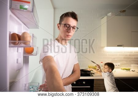 Camera Inside Kitchen Fridge: Man Opens Fridge Door, Looks Inside.