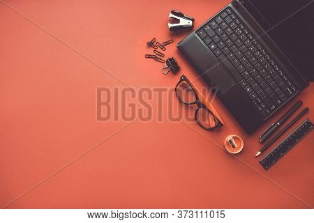 Home Office. Office Workplace With Laptop, Office Supplies And Stationery On Red Background. Solutio