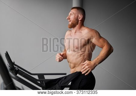 Man Running Treadmill Gym Athlete Jogging Indoor Weight Loss Workout Jogger Run Gray Wall Background