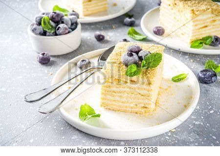 Homemade Baked Cake Napoleon, Millefeuille. Delicate Custard Cake Garnished With Berries And Mint. O
