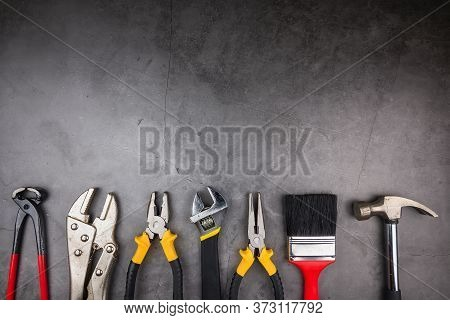 Home Repair Hand Tools On A Cement Gray Background. Concept Home Repair, Home Improvement, Renovate