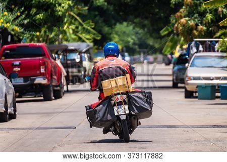 Bangkok, Thailand - May, 05, 2020 : Thailand Post, Postman Is Delivering Packages To Customers At Ba