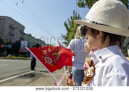Donetsk, Donetsk People Republic, Ukraine - June 24, 2020: Young Children Stand With Flags And Await