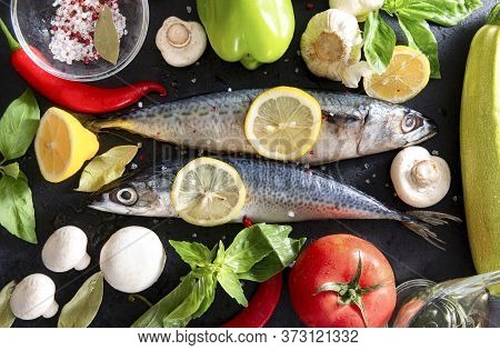 2 Raw Mackerel Fish With Lemon , Tomato, Basil, Chili Pepper,  Zucchini, Onion, Mushrooms And Spices