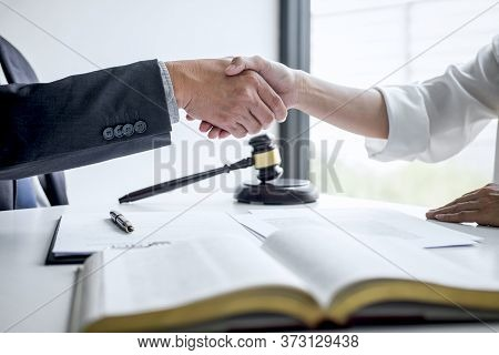 Good Service Cooperation Of Consultation Between A Male Lawyer And Business Woman Customer, Handshak