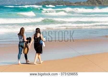 Bendalong, Australia 2020-06-06 Two Young Adult Girls Walking On A Scenic Beauriful Sandy Bendalong