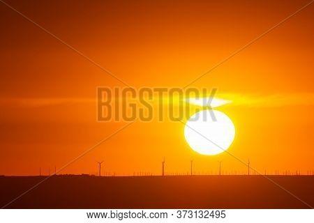 Orange Sunset, The Sun Sets Over The Horizon, Use As Background