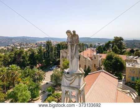 Abu Ghosh, Israel, June 13, 2020 : Statue Of The Mother Of God With A Baby In Her Arms On The Roof O