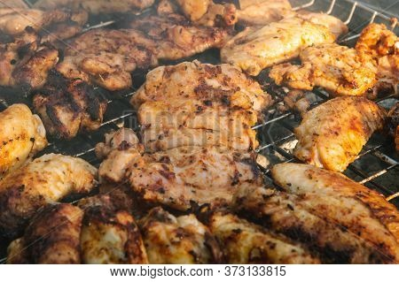 Close Up Of Delicious And Juicy Chicken Meat Being Cooked On A Charcoal Barbeque Grill. Tasty Snack