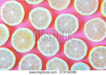 Collection Of Fresh Yellow Lemons Slice Isolated On Pink Background.