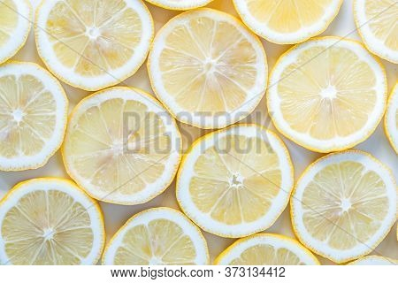 Collection Of Fresh Yellow Lemons Slice Isolated On White Background.