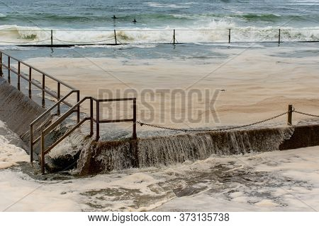 Ocean Storm Aftermath: A Mass Of Thick Foam Covered The Rock Pool Following Extreme Storm Weather At