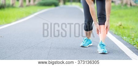 Young Adult Female With His Muscle Pain During Running. Runner Woman Having Leg Ache Due To Shin Spl