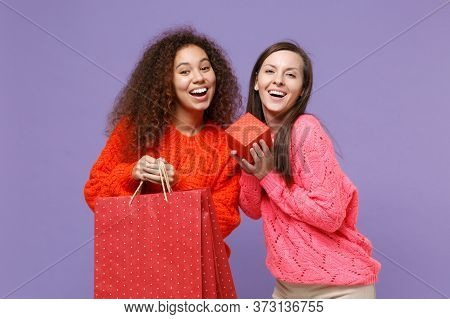 Cheerful European African American Women Friends In Sweaters Isolated On Violet Purple Background. P