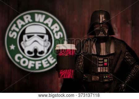 JUNE 21 2020: Humorous image of Star Wars Darth Vader with a coffee drink and a Star Wars Coffee sign - Hasbro action figure