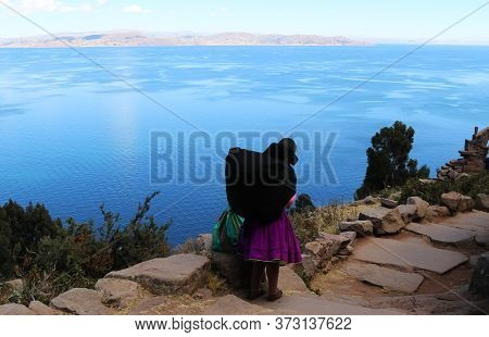 Inhabitant Of The Island Of Titicaca Descends Towards The Sea. Typical Daily Scene Of The Island Lif
