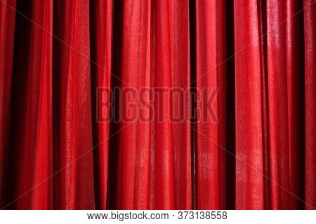 Luxury Red Closed Curtain With Light Spots In A Theater