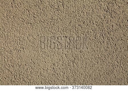 Cement Textured Coating, Texture, Background. Structural Plaster, Rough, Uneven Surface In Brown Or