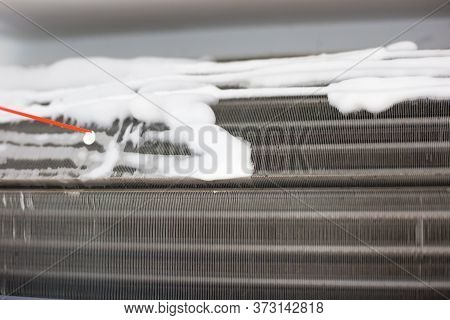 Technician Man Hand Cleaning Air Condition Filter With Chemical Foam