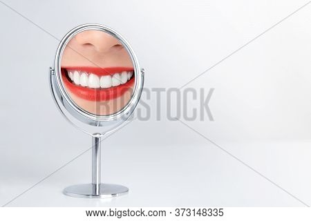 The Smile Of A Young Woman With Clean And Beautiful White Teeth Red Lips Reflections On The Mirror S