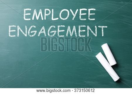 Text Employee Engagement And Chalk On Greenboard, Top View