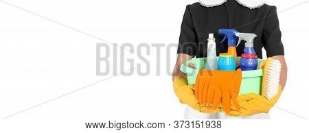 Young Chambermaid Holding Plastic Basin With Detergents On White Background, Closeup. Banner Design