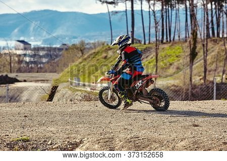 Motocross Driver In Action, Ready To Go And Looking Up For The Trail