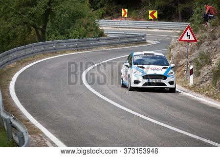 Skradin Croatia, June 2020 Blue Ford Fiesta Going Uphill At High Speed, Racing On Public Road