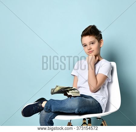 Teenage Boy In White T-shirt, Jeans And Sneakers. He Looking Thoughtful, Holding Fan Of Hundred Doll