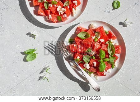watermelon salad with feta cheese and basil. healthy summer dessert