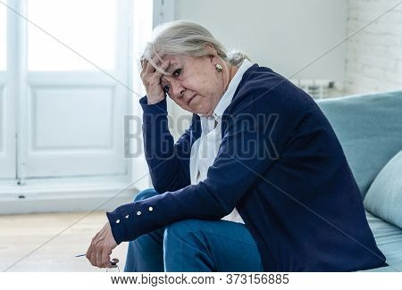 Lonely Depressed Senior Old Widow Woman Crying On Couch In Isolation At Home, Feeling Sad And Worrie