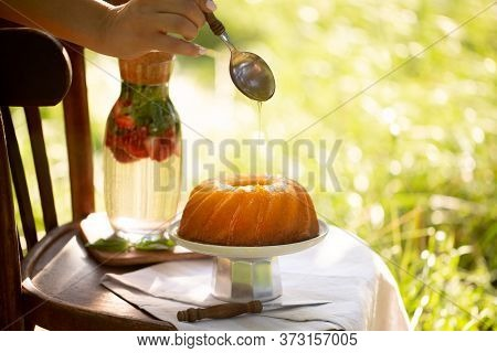 Cupcake With Syrup.cupcake With Maple Syrup.agave Syrup Is Pouring On A Cupcake.pie In The Summer Ga
