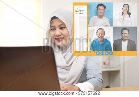 Asian Muslim Woman Doing Teleconference Due To Coronavirus Covid Pandemic. Webcam Pc Screen Views Du